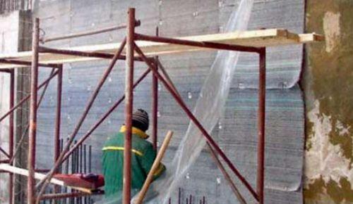 Монтаж бентонитовых матов на стену фундамента. Выпуски арматуры - под прижимную железобетонную стенку