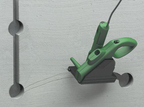 Шаг второй: при помощи перфоратора режутся отверстия под коробки и штроборезом или болгаркой делаются штробы между ними
