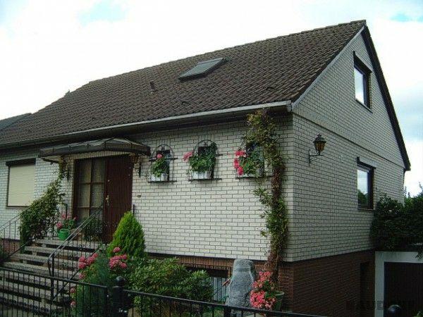 Фасад дома отделан клинкерными термопанелями