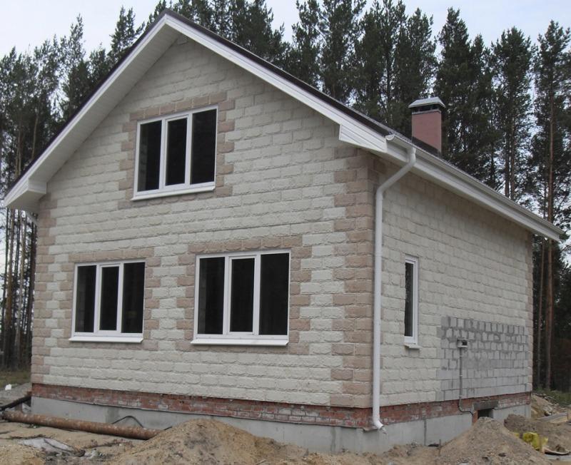 Дом из многослойных утепленных блоков